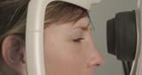 Young woman having eye examination