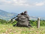 backpack and trekking poles