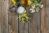 Ancient herbal medicine on wooden background