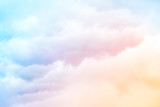 Rainbow Clouds.  A soft cloud background with a pastel colored orange to blue gradient. - 115672402