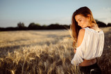 Beautiful woman and barley fields