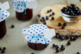 Homemade blueberry jam in a jar and fresh blueberries.Health and