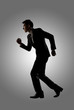 Confident businessman running