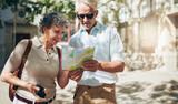Senior couple reading a tourist map