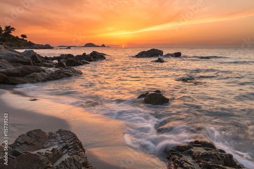 Foto op Canvas Zee zonsondergang Beautiful sunset over coast and L'Ile Rousse in Balagne region o