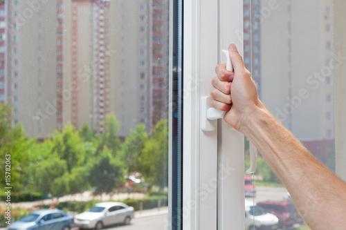 Poster Man Hand opens a plastic pvc window