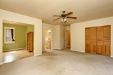 Fototapety Old craftsman style house with beige interior paint.