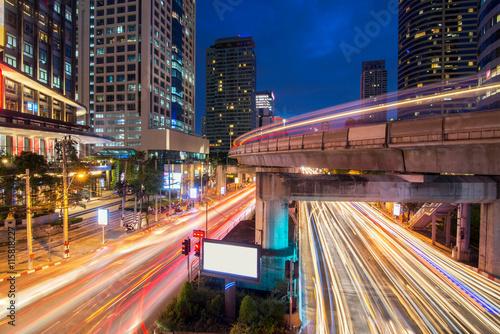 Foto op Aluminium Nacht snelweg Traffic light and sky train in busy light trails at night - Bangkok, Thailand