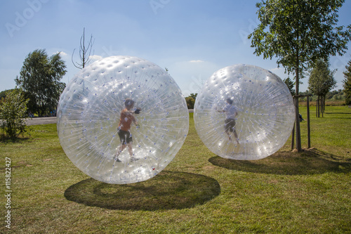 Poster children have fun in the Zorbing Ball
