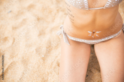 Woman body with sun cream and swim suit © kikearnaiz