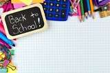 Back to School chalkboard tag with school supplies corner border on graphing paper background