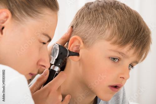 obraz lub plakat Doctor Examining Boy's Ear