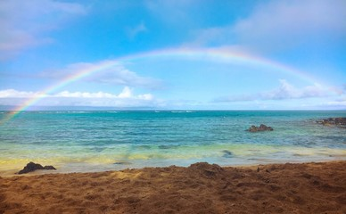 full rainbow at beach