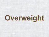 Health concept: Overweight on fabric texture background