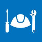 Icono plano casco con herramientas en fondo azul