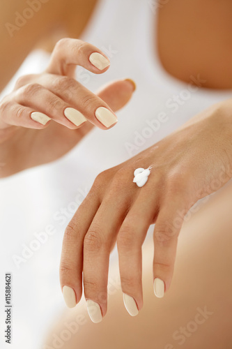 Tela Hand Cream. Close Up Of Woman's Hands Applying Lotion On Skin