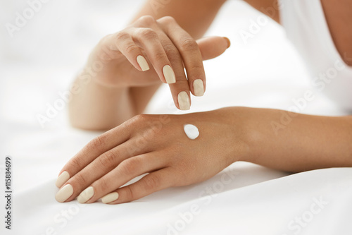 Tela Woman Hands With Cream. Closeup Of Female Hands Applying Lotion