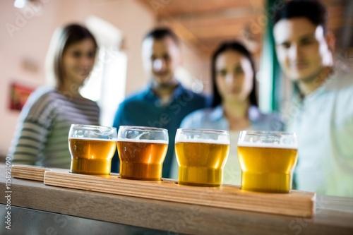Friends in front of beer sampler Poster