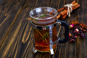 Herbal Tea with Thyme, Mint and Cinnamon on Wooden Rustic Backgr © ArtCookStudio
