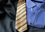 Men`s blue shirt and yellow tie