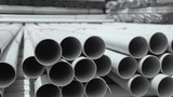 PVC pipes stacked in warehouse. - 115931254
