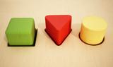 Cube, prism and cylinder wooden blocks inside holes. 3D illustration