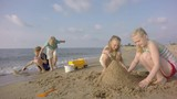 Storm on the sea. Cloudy sky. Slow motion. Sand Toys On The Beach. Children build sand.