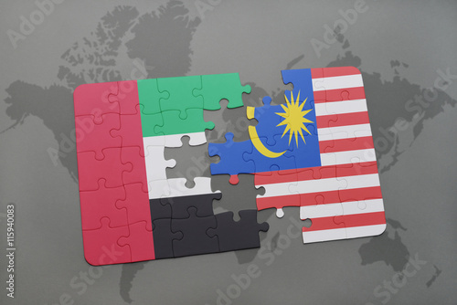 puzzle with the national flag of united arab emirates and malaysia on a world map background.