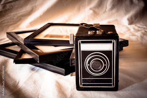 obraz PCV Vintage toned image of retro camera and photographs in frames