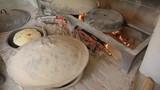 Baking of bread.Baking bread in a stone oven