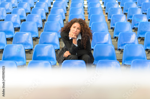 Bored young woman sitting waiting