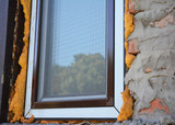 House outdoor lighting. Electric outdoor house lamp on brick wal