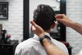 Combing process in barbershop face closeup