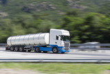 Truck moving fast on the highway with panning effect