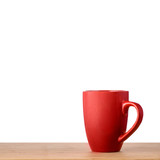 Red cup on the table with isolated background - 116013808