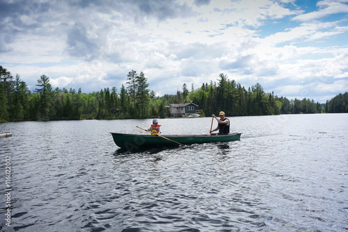 contryside ontario canada nature father and son canoe fishing