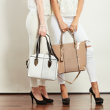 Two ladies holding handbags.