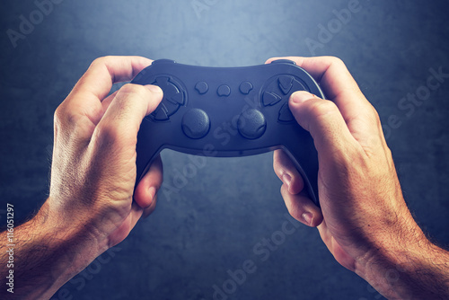 Poster Man using game pad controller to play video games