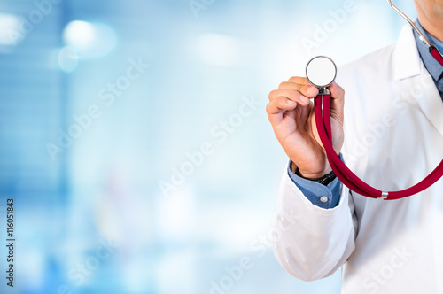 obraz lub plakat Doctor Holding A Stethoscope For Auscultation