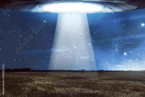 UFO flying in a dark sky Poster