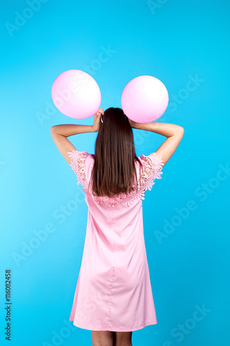 Playful girl with balloon ears in pink dress Poster