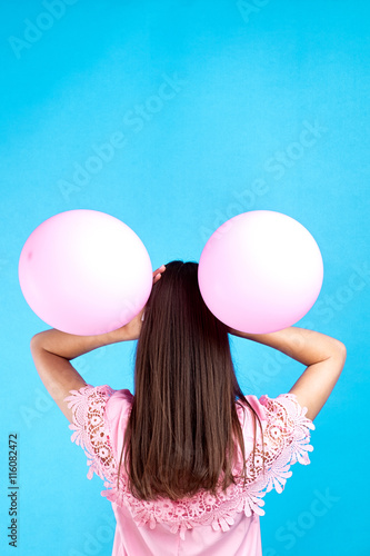 rear view of young brunette with two pink balloons on head Poster