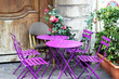 Bright tables and flowers at the Paris café.