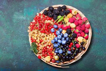 fresh berries on green background