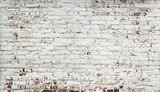 Fototapety Stripped bricks red wall with paint in white
