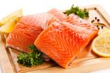 Fresh raw salmon steaks on cutting board