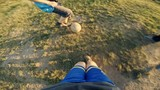 POV: Football with children in the village. View from the face of football.