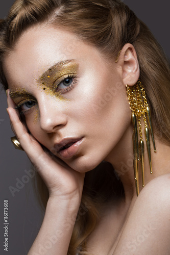 Tela Beautiful girl in Underwear with creative gold makeup and hair