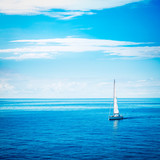 White Yacht Sailing in Calm Blue Sea