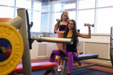 Sport. Cute girlfriends training in fitness room